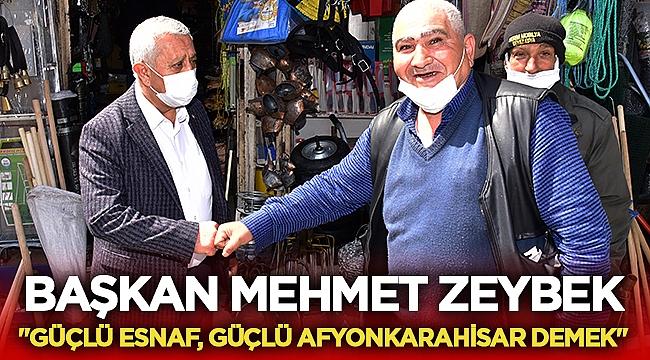 Mehmet Zeybek her fırsatta esnafı ziyaret ediyor