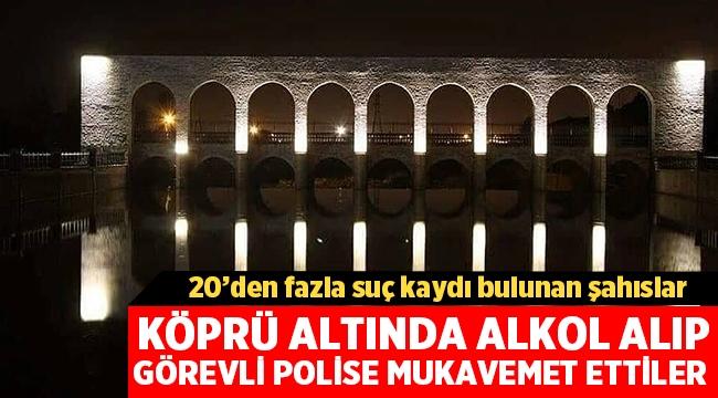 Akarçay köprü altında alkol alıp, görevli polise mukavemet ettiler